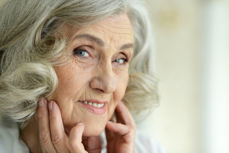 Portrait of beautiful smiling senior woman posing stock image