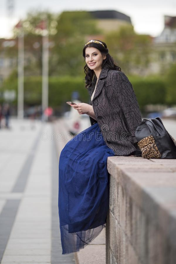 Portrait of Beautiful Smiling Woman With Cellphone Outdoors royalty free stock image