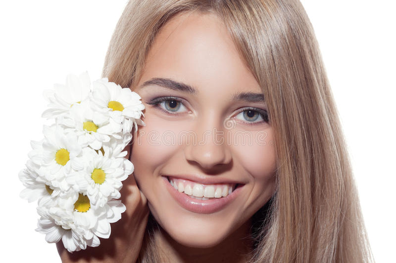 Portrait Of Beautiful Smiling Woman With Flowers. Clear Skin. White background stock photo