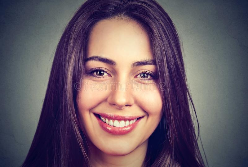 Portrait of a beautiful smiling woman with perfect white teeth stock photo
