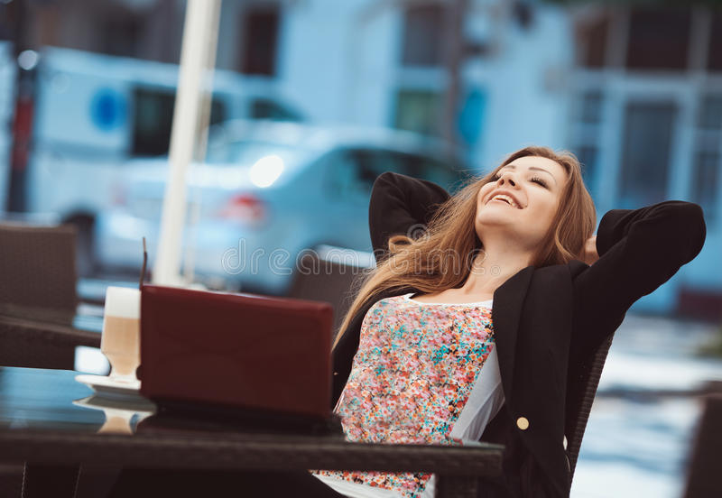 Download Portrait Of Beautiful Smiling Woman Sitting In A Cafe With Laptop Outdoor Stock Image - Image: 36217173