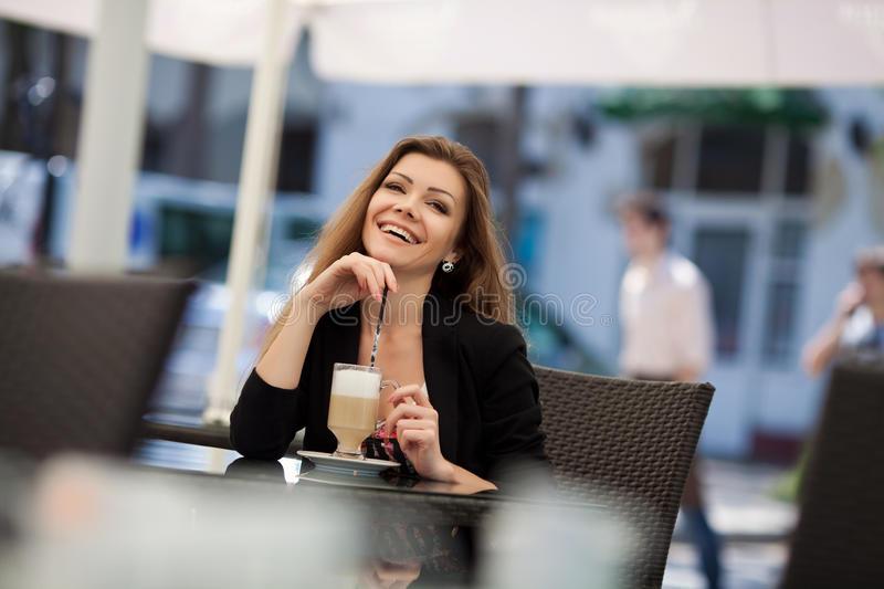 Download Portrait Of Beautiful Smiling Woman Sitting In A Cafe With Laptop Outdoor Stock Photo - Image: 36217202