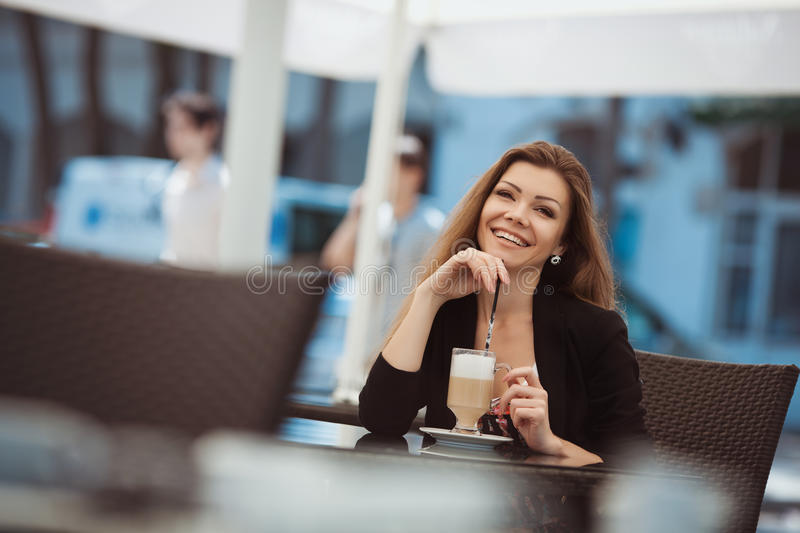 Download Portrait Of Beautiful Smiling Woman Sitting In A Cafe With Laptop Outdoor Stock Image - Image: 36217207