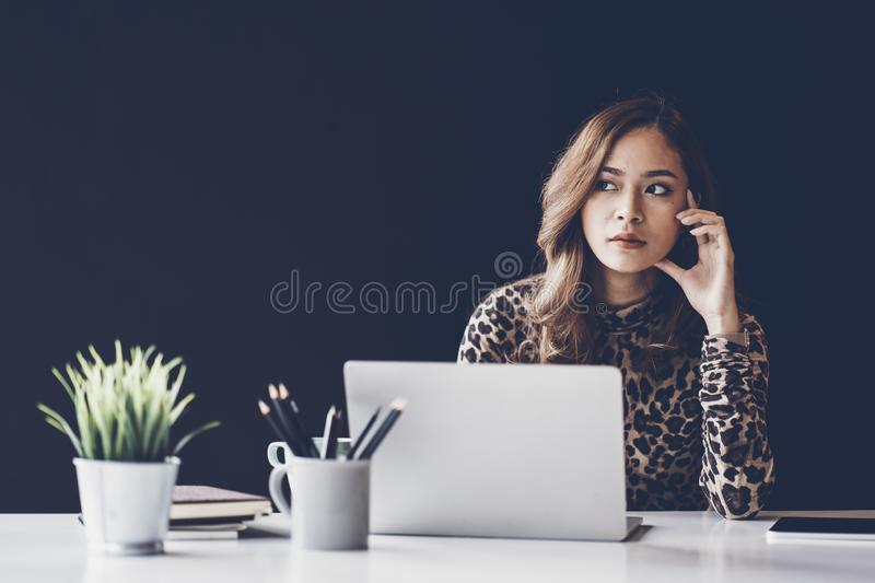Portrait of beautiful smiling young  entrepreneur businesswoman working in modern work station stock images