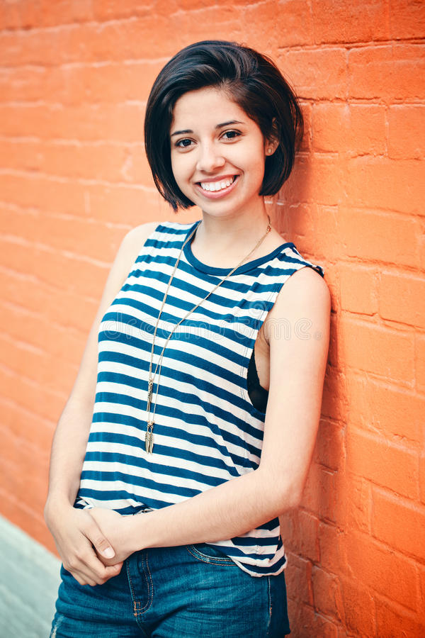 Portrait of beautiful smiling young hipster latin hispanic girl woman with short hair bob stock photos