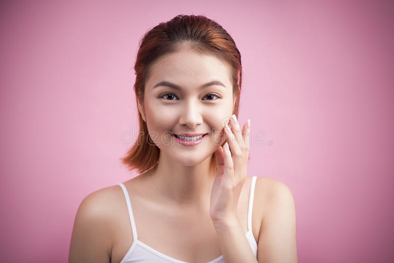 Portrait of a beautiful smiling young woman with natural make-up. Skincare, healthcare. Healthy teeth. Studio shot. Isolated on P stock photography