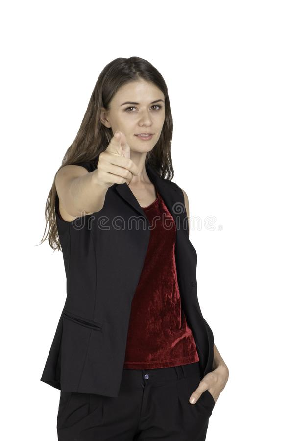Portrait of beautiful standing posing young woman and pointing straight at the camera royalty free stock photos