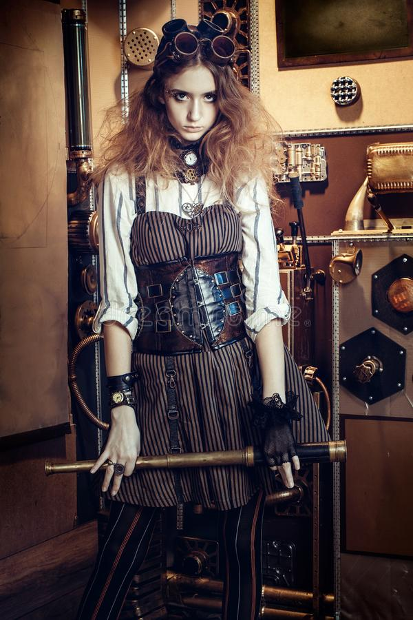 Portrait of a beautiful steampunk woman, with a telescope and pr royalty free stock images