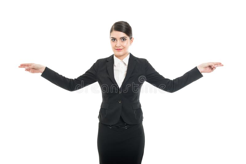 Portrait of beautiful stewardess showing both exit ways royalty free stock image