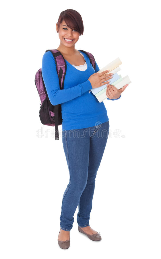 Portrait Of Beautiful Student Girl With Books Stock Photo