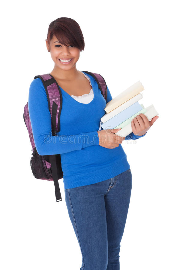 Portrait of beautiful student girl with books royalty free stock image