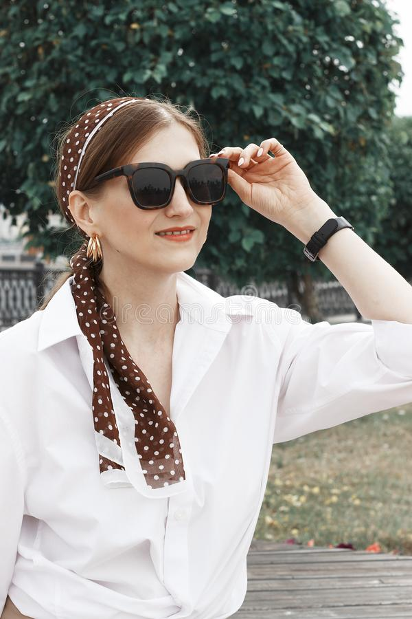 Portrait of a beautiful stylish girl with a turban on her head, side view stock photos