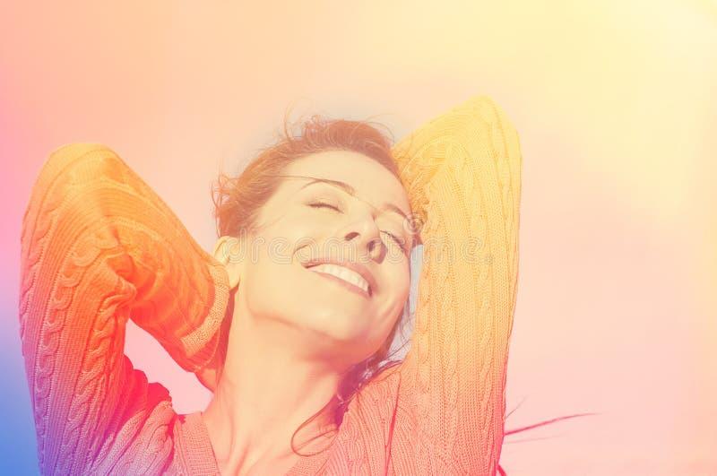 Portrait of a beautiful sunshine girl. stock photo