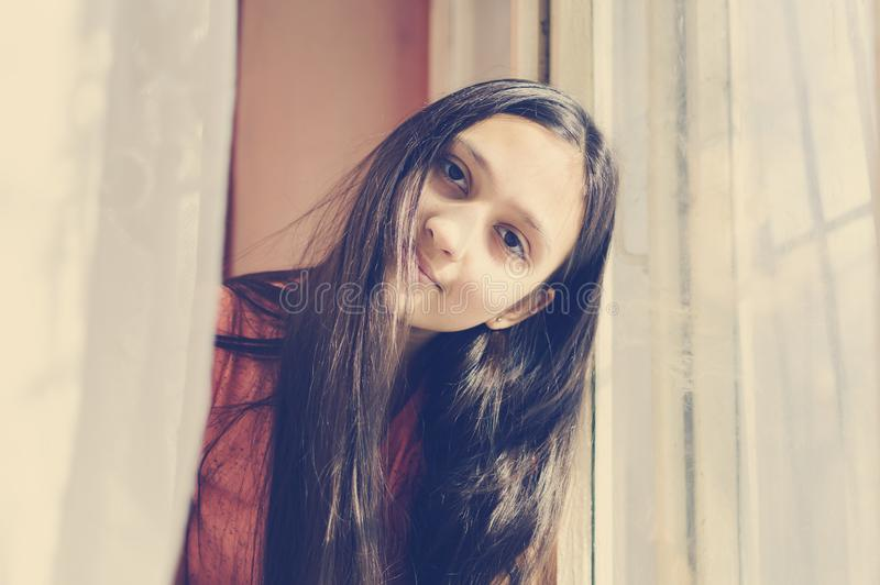 Portrait of a beautiful teenage girl with long hair. Lifestyle style. Toning in the style of instagram stock photography