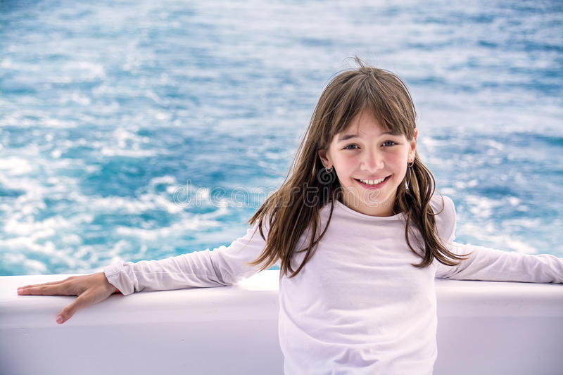 Portrait of a beautiful teenage girl on a yacht, on the background of the sea, stock photography
