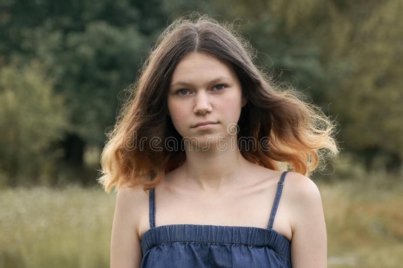 Portrait of beautiful teenager girl 15 years old, with brown flying hair stock photography
