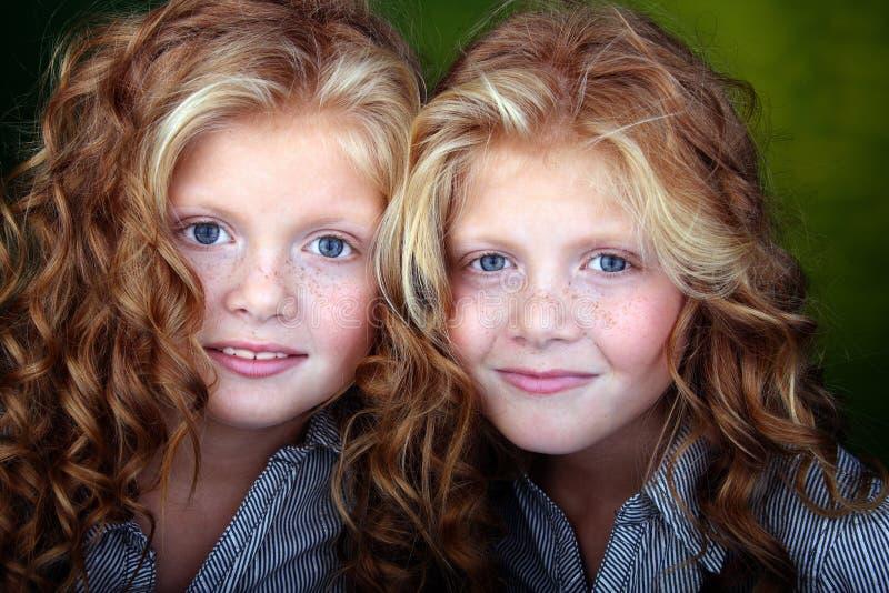 Portrait of beautiful twin girls royalty free stock photography