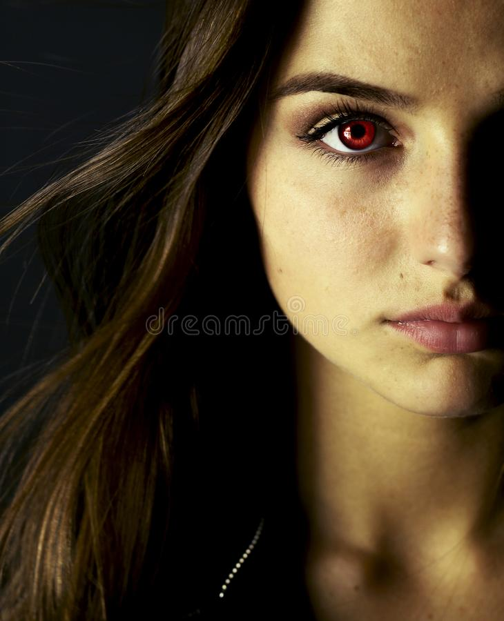 Portrait of beautiful vampire young woman royalty free stock photo