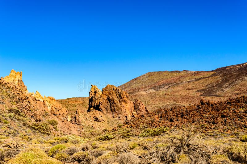 Portrait Of A Beautiful Volcanic Rock Formation In The Form Of A Camel On A Sunny And Very Clear Day In El Teide National Park. royalty free stock photo