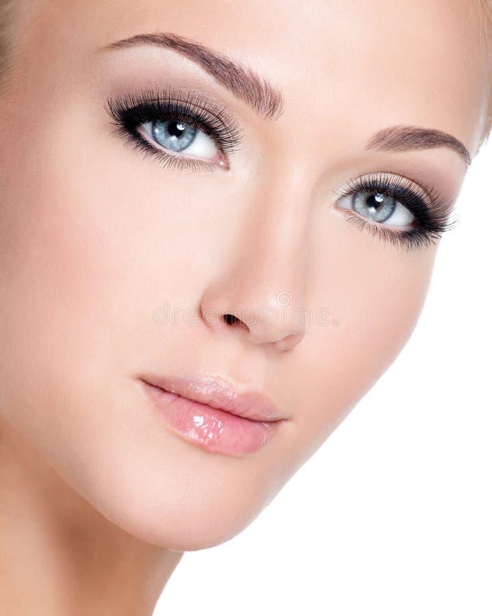 Portrait of beautiful white woman with long false eyelashes royalty free stock photography