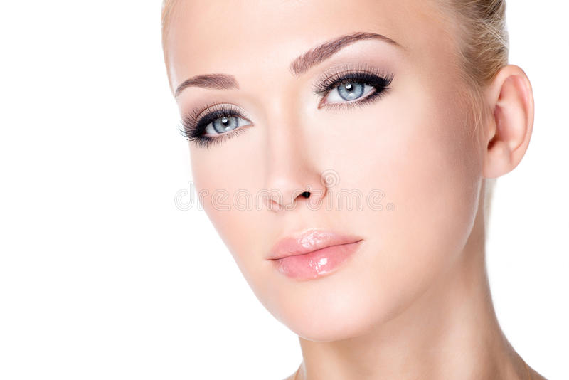 Portrait of beautiful white woman with long false eyelashes royalty free stock image