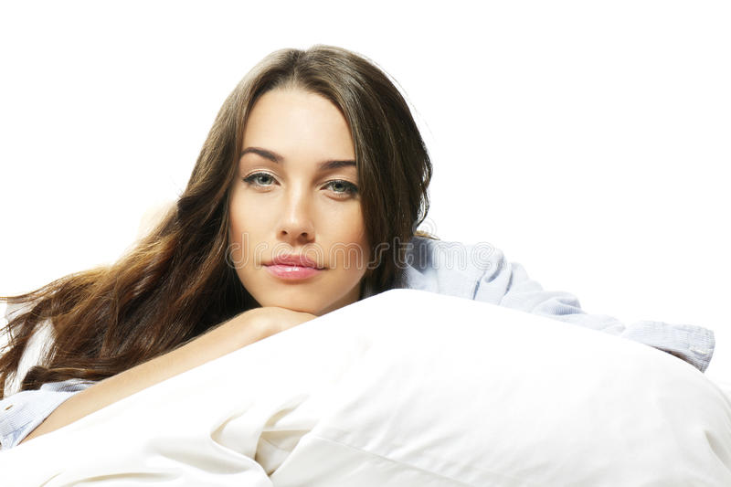 Portrait of a beautiful woman in bed royalty free stock photography