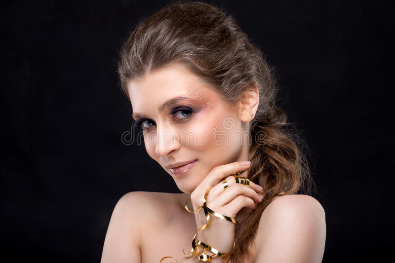 Portrait of a beautiful woman on a black background. stock photo