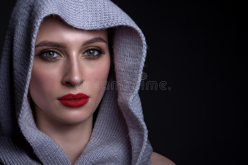 Portrait of a beautiful woman on a black background royalty free stock images