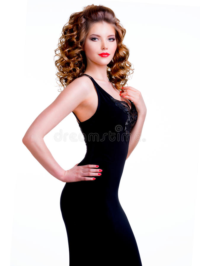 Portrait of beautiful woman in black dress. royalty free stock photography