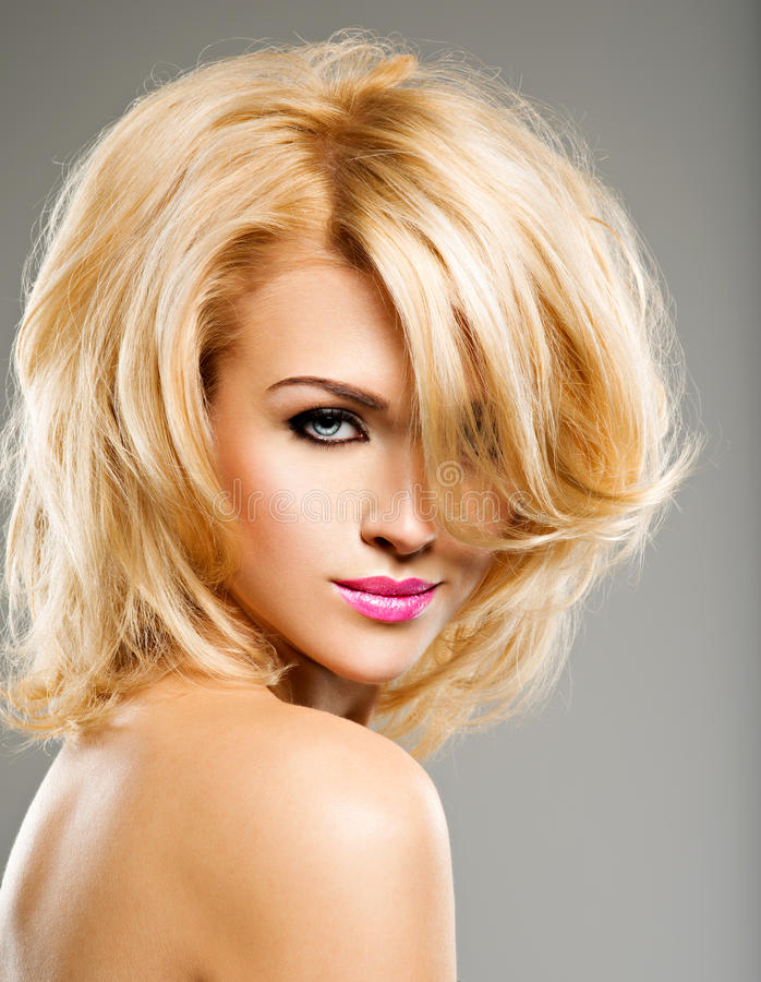 Portrait of beautiful woman with blond hair. bright fashion ma stock images