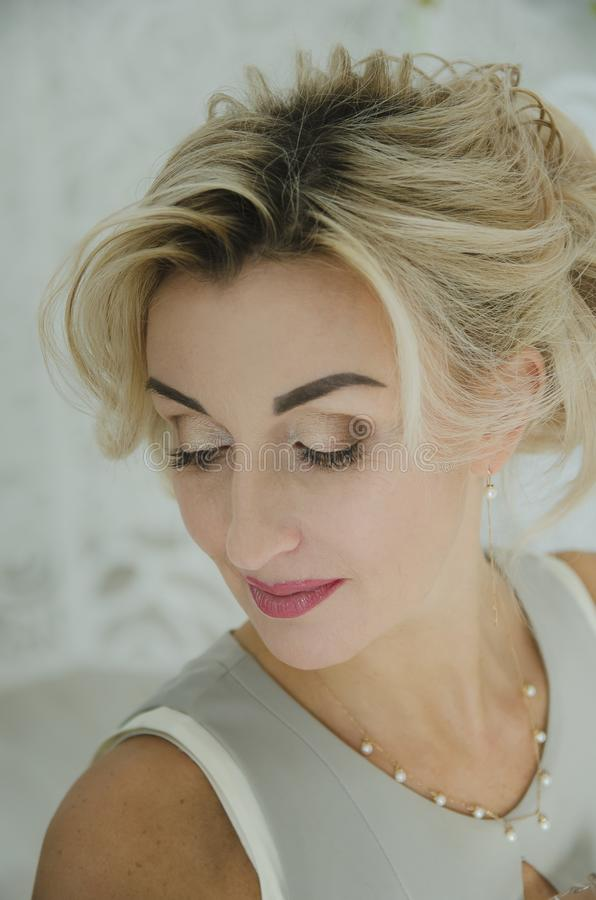 Portrait of a beautiful woman with blond hair royalty free stock image