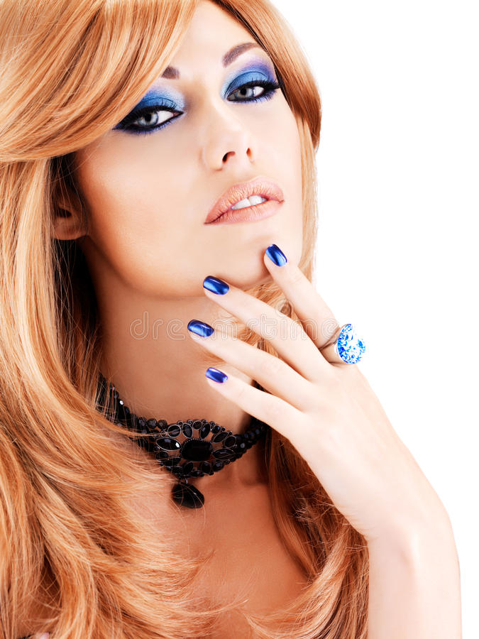 Portrait of a beautiful woman with blue nails, blue makeup stock images