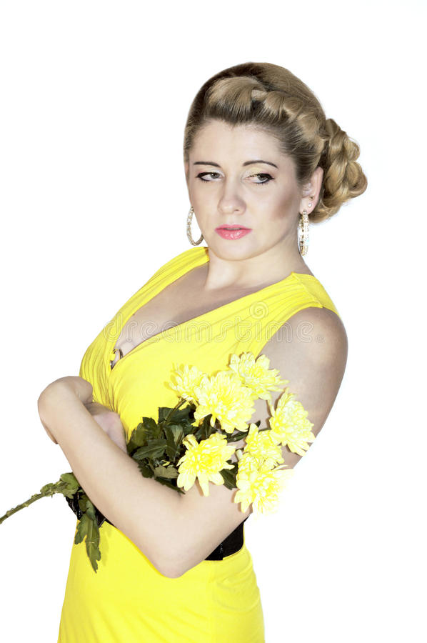 Portrait of the beautiful woman with a bouquet of yellow flowers royalty free stock image