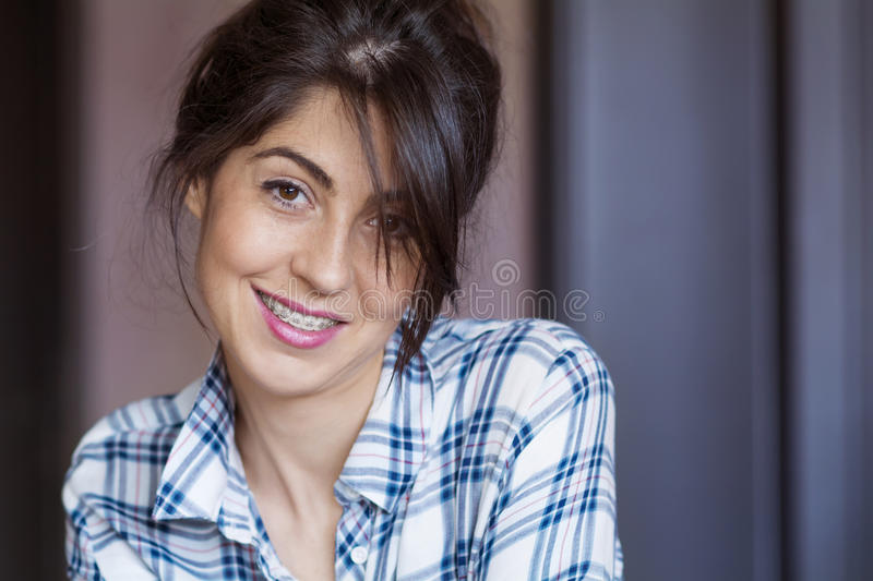 Portrait of a beautiful woman with braces on teeth.Orthodontic Treatment. Dental care Concept. Portrait of a beautiful smiling woman with braces on teeth royalty free stock photography