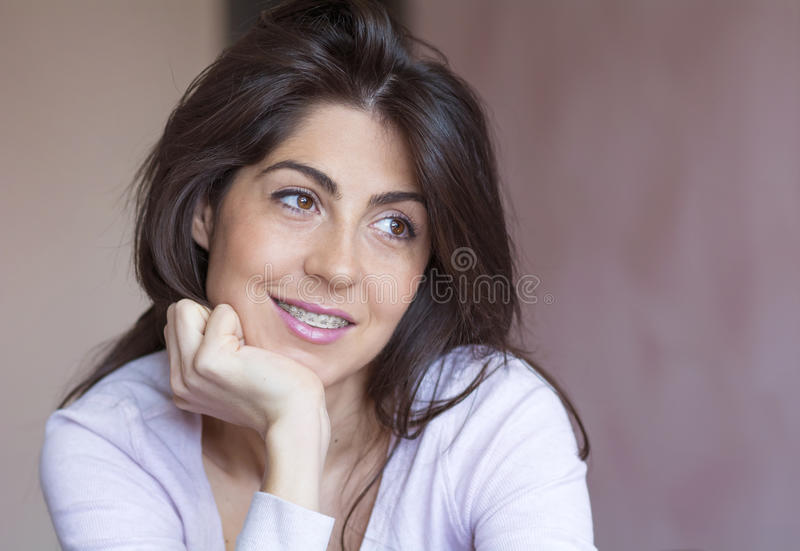 Portrait of a beautiful woman with braces on teeth.Orthodontic Treatment. Dental care Concept royalty free stock images