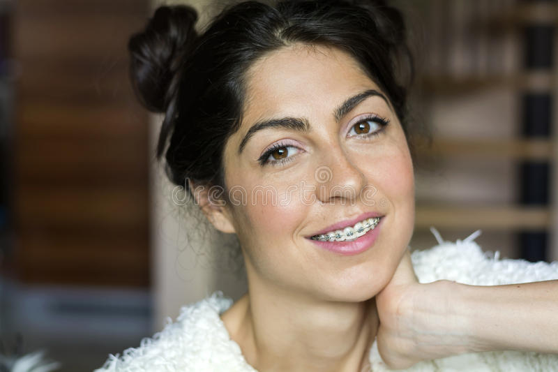 Portrait of a beautiful woman with braces on teeth.Orthodontic Treatment. Dental care Concept stock photography