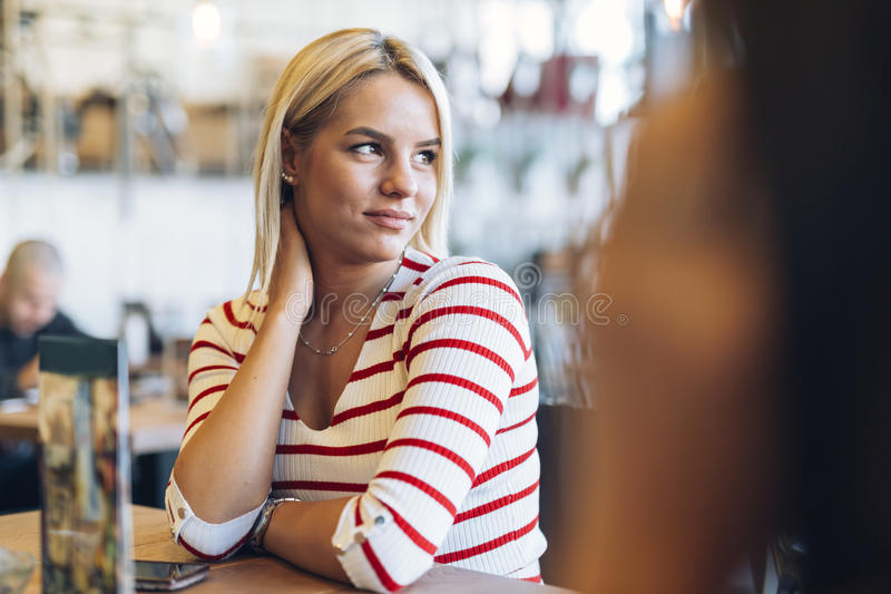 Portrait of beautiful woman in cafe stock photography