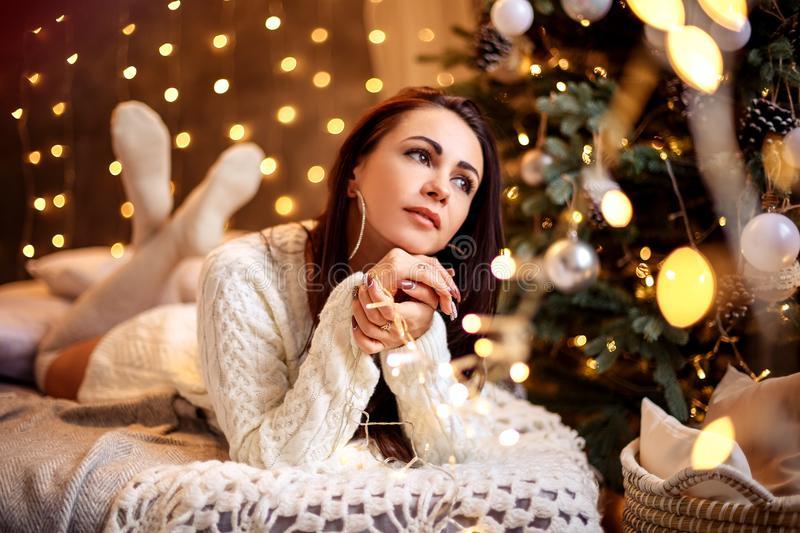 Portrait of a beautiful woman in the Christmas decorations, festive mood.  stock images