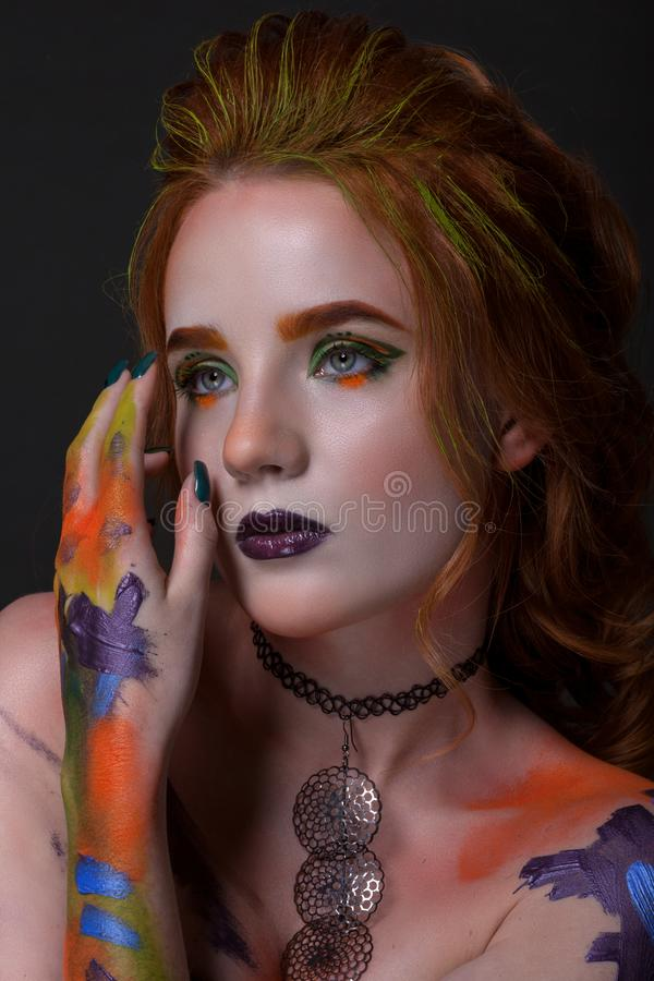 Portrait of a beautiful woman with a creative style stock photography