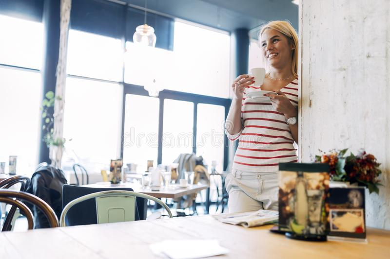Portrait of a beautiful woman drinking coffee stock photography