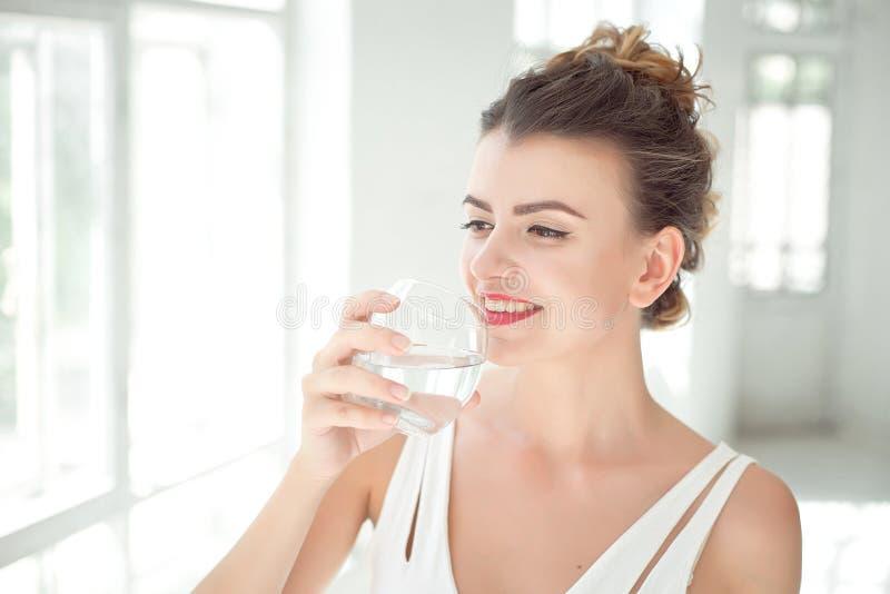 Portrait of a beautiful woman drinking water stock photo