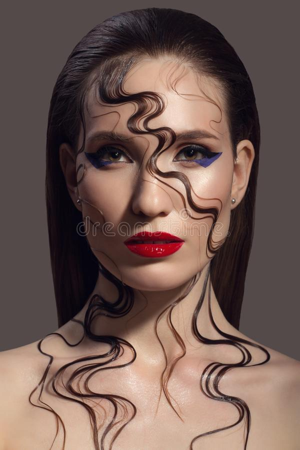 Portrait of beautiful woman. Fantasy make-up. stock photography