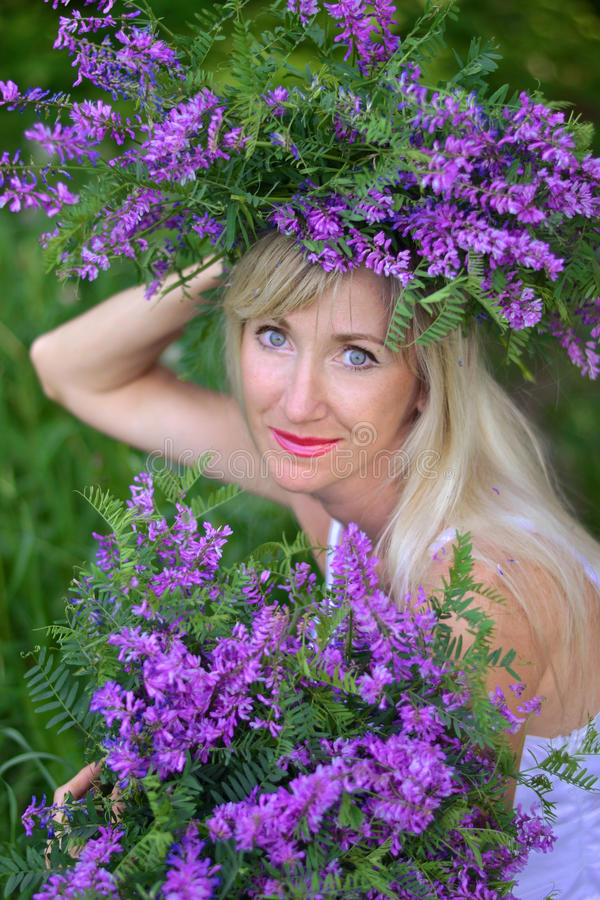Portrait the beautiful woman with flowers stock photos