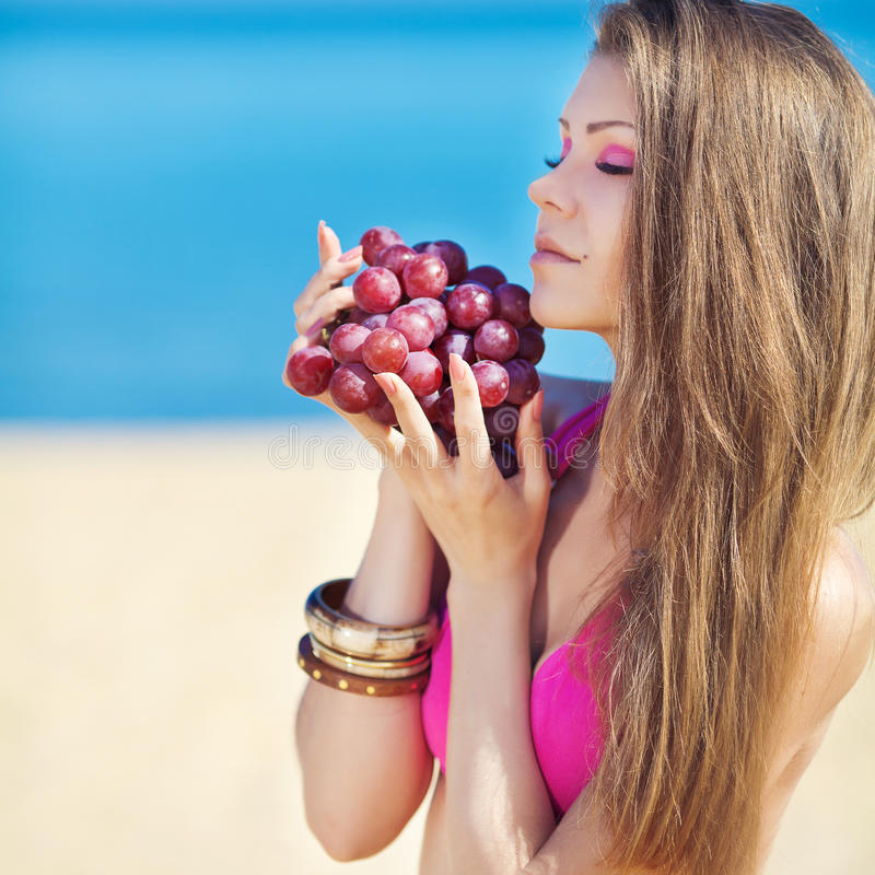 Portrait Of Beautiful Woman With Grapes In Hands In Summer Outdoor Stock Images