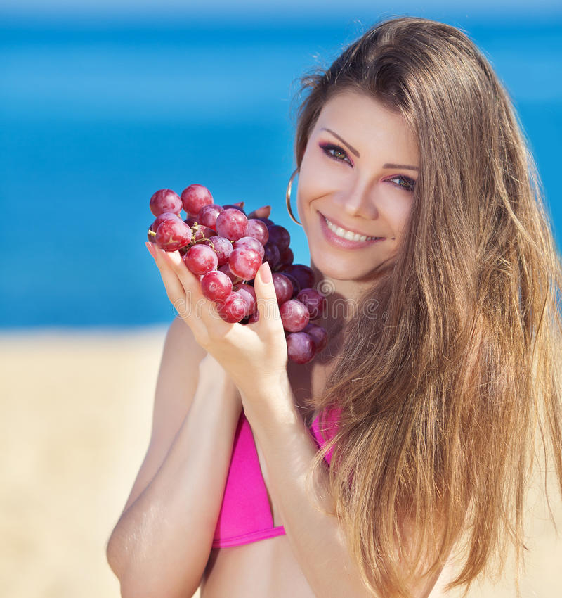 Download Portrait Of Beautiful Woman With Grapes In Hands In Summer Outdoor Stock Image - Image: 36219365