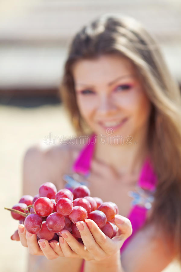 Download Portrait Of Beautiful Woman With Grapes In Hands I Stock Photo - Image: 36219372