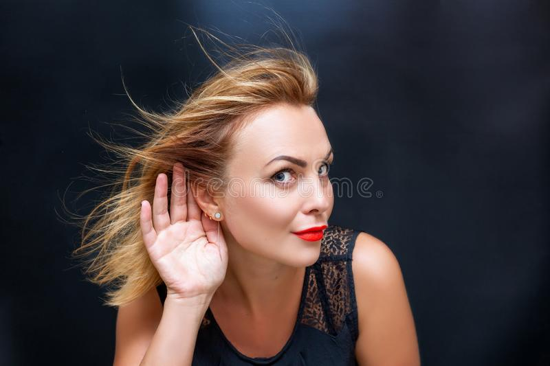 Portrait of a beautiful woman with a hand near her ear stock photos