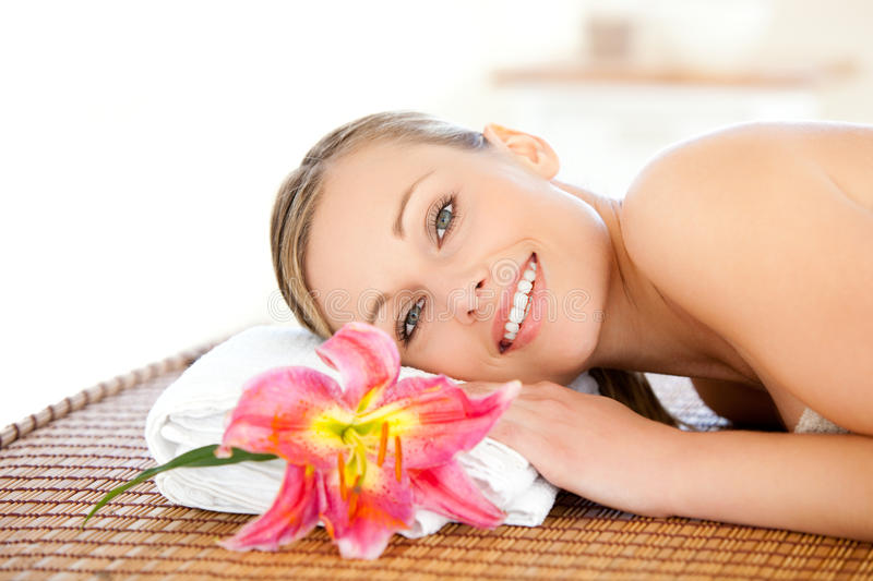 Portrait of a beautiful woman having a massage. In a spa stock image