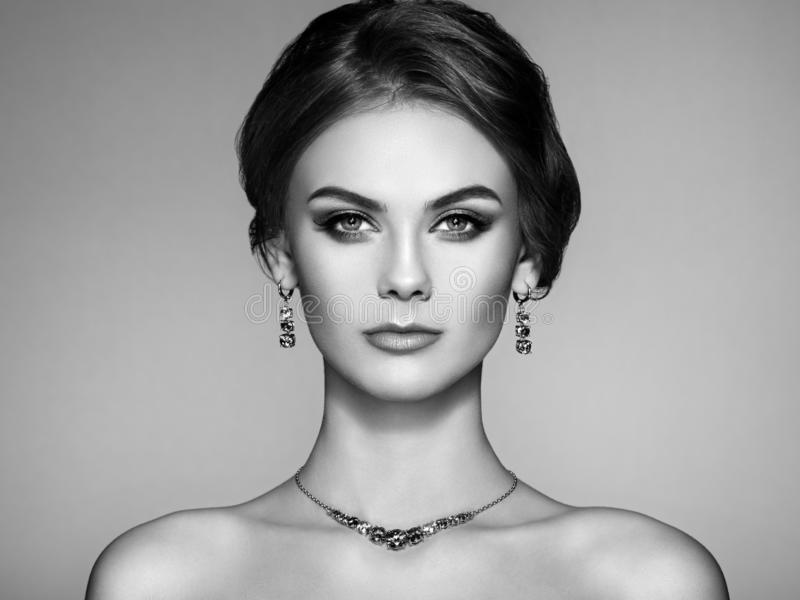 Portrait Beautiful Woman with Jewelry. Fashion Makeup and Cosmetics. Elegant Hairstyle. Make-up Arrows. Beauty and Accessories stock images