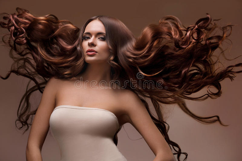 Portrait of Beautiful Woman with Long flying Hair. stock photography